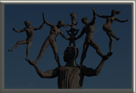 statue of large bronze man juggling 6 people
